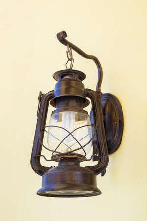 metal wall: Vintage lantern on a wall.
