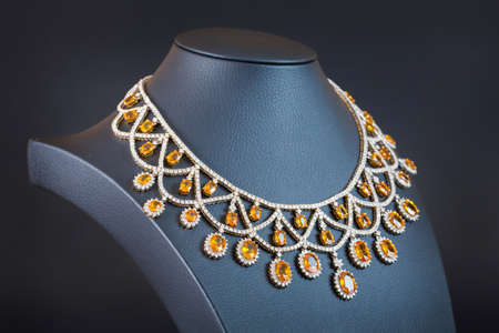 diamond necklace: diamonds with yellow sapphire necklace on the black background