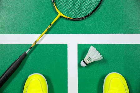 badminton: badminton - badminton courts with players competing