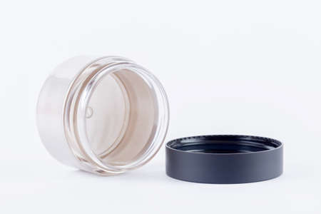 compatibility: container of cream on white background