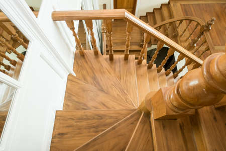 classic wooden staircase in luxury home entrance hall