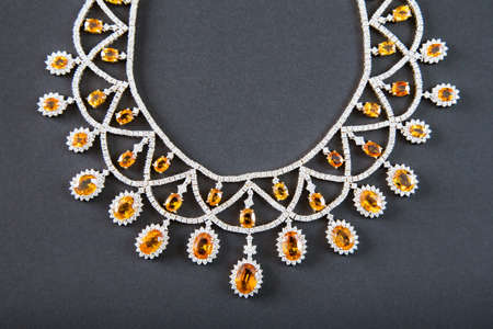 diamonds with yellow sapphire necklace on the black background
