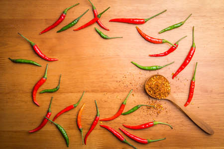 Chili on wooden background