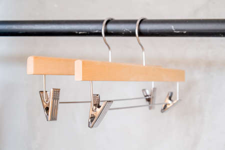 clothes rail: Coat hangers on clothes rail