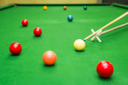 snooker cue: Snooker player placing the cue ball for a shot Stock Photo