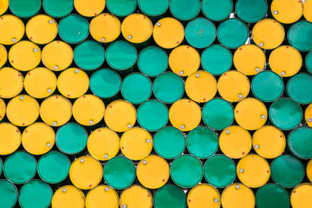 dirty environment: background of oil tanks stacked in a row Stock Photo