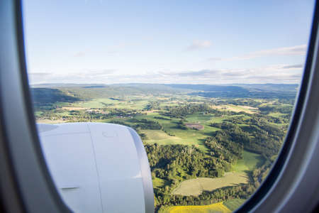 aerial photograph: Aerial photograph area on agriculture and village as seen through window of an aircraft