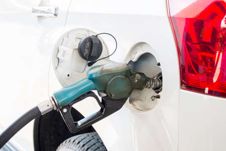 fill up: Gun petrol in the tank to fill Stock Photo