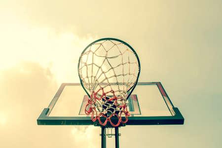 intramural: Basketball hoop and sky ,Sport  : vintage filter effect