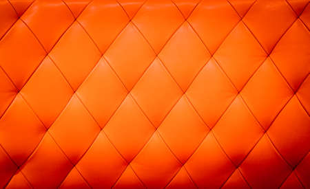 padding: Closeup texture of vintage red leather sofa for background