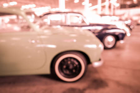 show room: Abstract blurred photo of car show room - vintage filter
