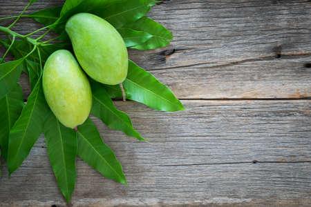 green mango on wooden background