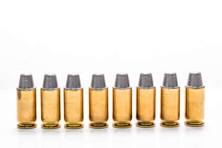 .45mm bullet for a gun isolated on white background. Stock Photo