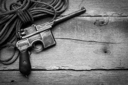 flintlock: vintage submachine gun Mauser on old wooden background