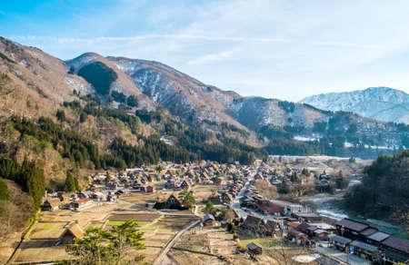 shirakawa go: Shirakawa Go (Shirakawa-go) Beautiful Reflection of The Historic Villages and Cherry Blossom Sakura in Spring Season. Shirakawago Traditional Houses in the Gassho Zukuri Style, Gifu, Japan