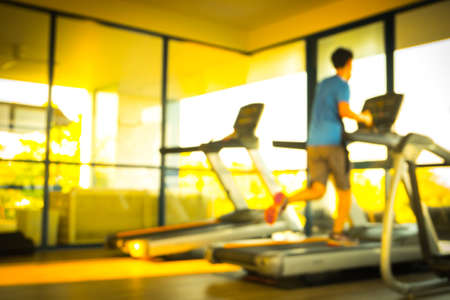 treads: Blur a man running on treadmill - effect filter color