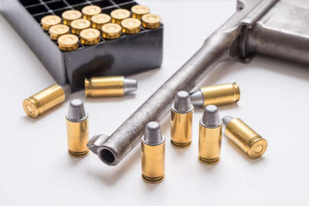 full metal jacket: .45mm bullet with gun isolated on white background.