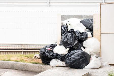 black plastic garbage bag: Black and white plastic garbage bags