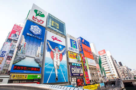 Osaka, Japan - january 25, 2015: The Glico Man billboard and other light displays at Dontonbori, Namba Osaka area, Osaka, Japan. Namba is well known as an entertainment area in Osaka. Éditoriale