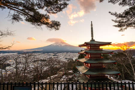 sengen: sunet at Mt. Fuji with red pagoda in winter, Fujiyoshida, Japan