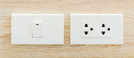 switches: Switches and sockets set on wall Stock Photo