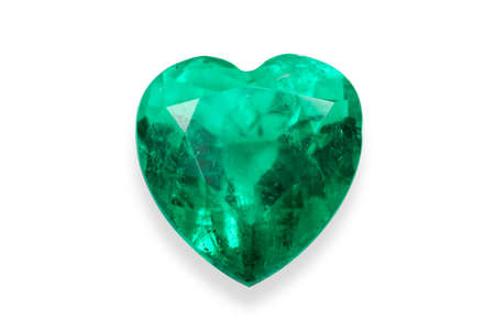 Emerald green It is a natural green gemstone heart shape isolated on white