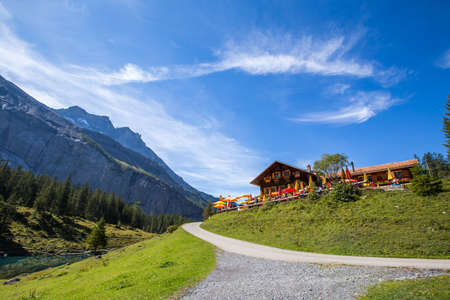 The panorama in summer view over the Oeschinensee (Oeschinen lake) view from cafe Stock Photo