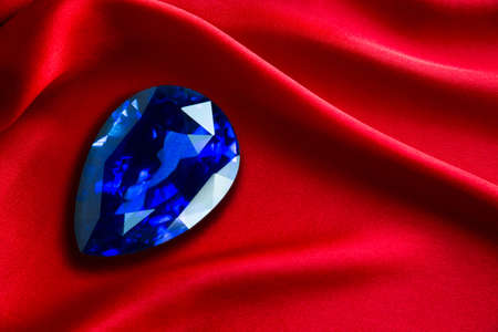 Blue sapphire on red background luxury cloth or liquid wave or wavy folds of grunge silk texture
