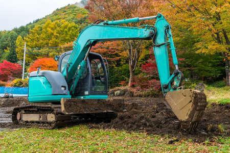 Excavators machine in park