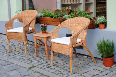 condo: wooden chair in front of cafe Stock Photo