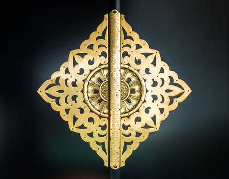 A beautiful golden door knob with ornaments in japan Stock Photo