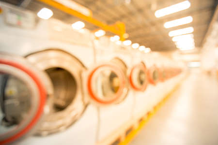 blur background laundry machines in factory