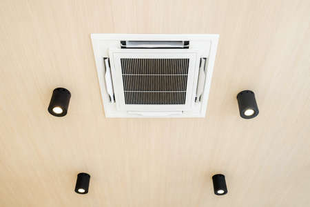 Ceiling mounted cassette type air conditioner Stock Photo