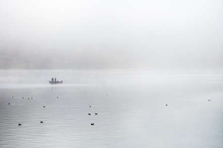Fishing in the morning fog on the lake in japan