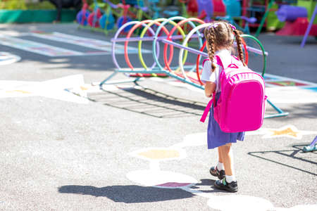 little girl with a backpack going to school Stock Photo - 85840203
