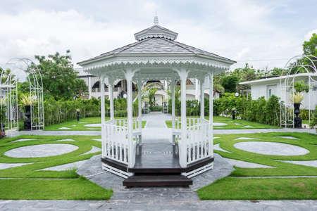 White pavilion in the garden.