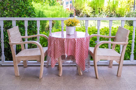 Garden table and chairs Stock Photo - 86936213