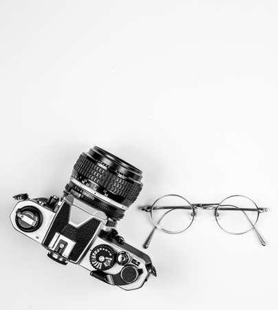Vintage camera on white wooden background
