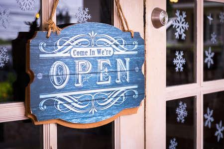 Open sign on the door of a shop