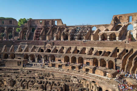 ROME, ITALY - july 23 2017: Tourists visiting the interior of the Colosseum, one of the New Seven Wonders of the World