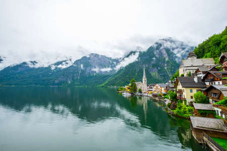 view of famous Hallstatt mountain village with Hallstaetter Lake in the Austrian Alps, region of Salzkammergut, Austria