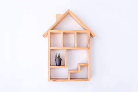 Wooden box with home shape secorated on wall