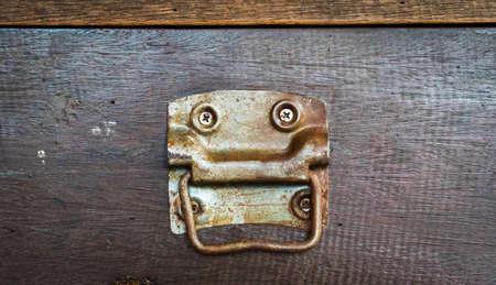 closeup vintage wooden handle on old brown wood drawer