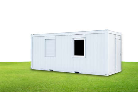 White Container office with door and window on green lawn isolated on white background Stock Photo