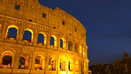Colosseum in Rome at twilight , Italy