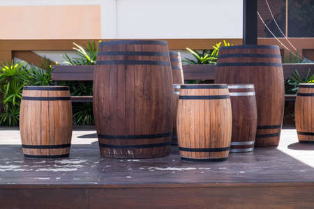 Wooden wine barrel table with chairs Stock Photo