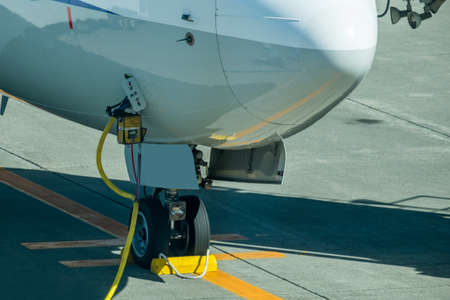 landing gear of airplane in airport, preparing for take-off