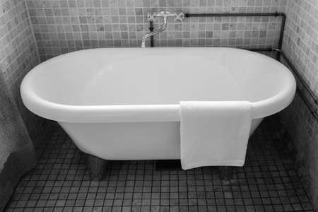 Towel on classic bathroom with old bathtub