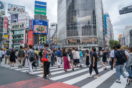 TOKYO, sep 27, 2017: Pedestrians cross at Shibuya Crossing. It is one of the worlds most famous scramble crosswalks. Editorial