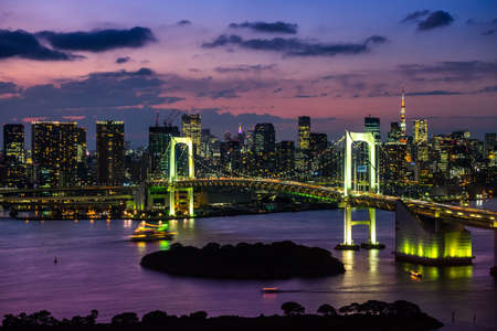 Tokyo Tower skyline and Rainbow Bridge with cityscape at Odaiba Japan Stock Photo